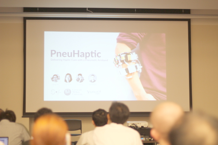 PneuHaptic: Delivering Haptic Cues with a Pneumatic Armband