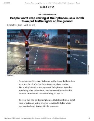 People won't stop staring at their phones, so a Dutch town put traffic lights on the ground