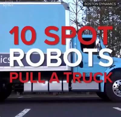 10 Spot robots pull a truck